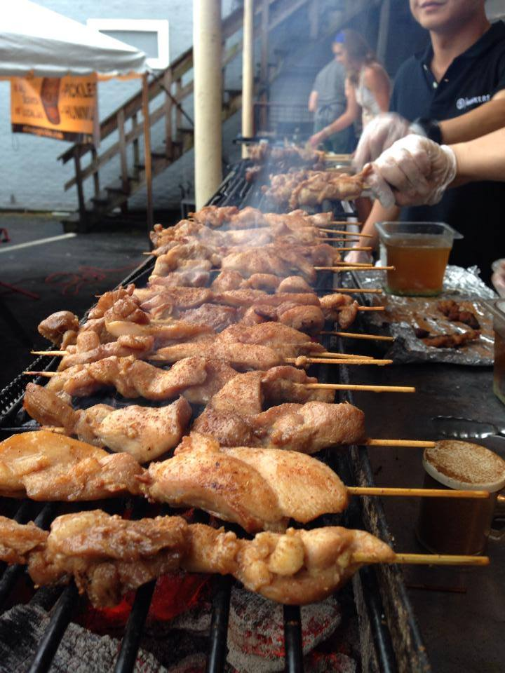Grilling up the skewers of meat at Hawker's Asian Street Fare (Photo: Courtesy of Hawker's Asian Street Fare)
