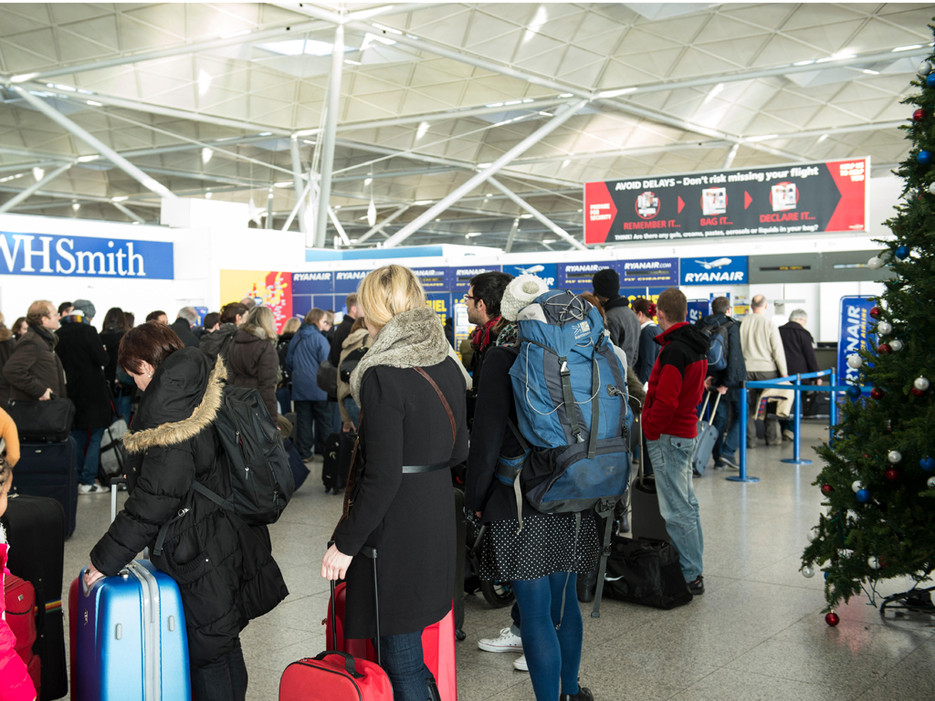 Holiday travel at overcrowded airports. (Photo: © Allsorts Stock Photo / Alamy)