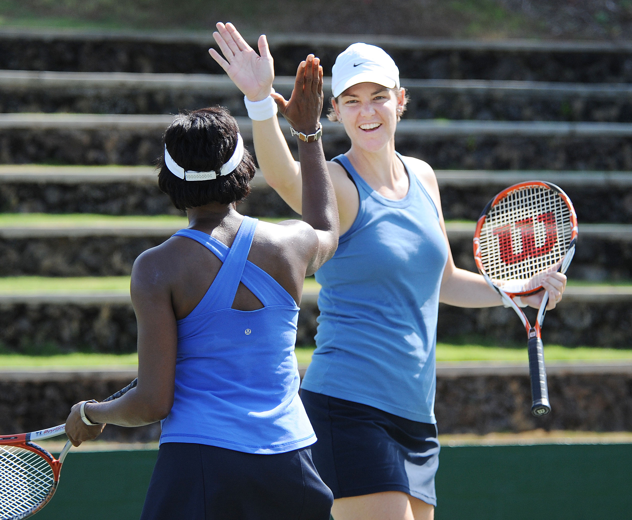 Lindsay Davenport, background, gives New Jersey's Lisa Webber, foreground, a high five after Lisa's put-away at the net at the Wailea Tennis Fantasy Camp 2010. (Photo: Courtesy of PR Web)