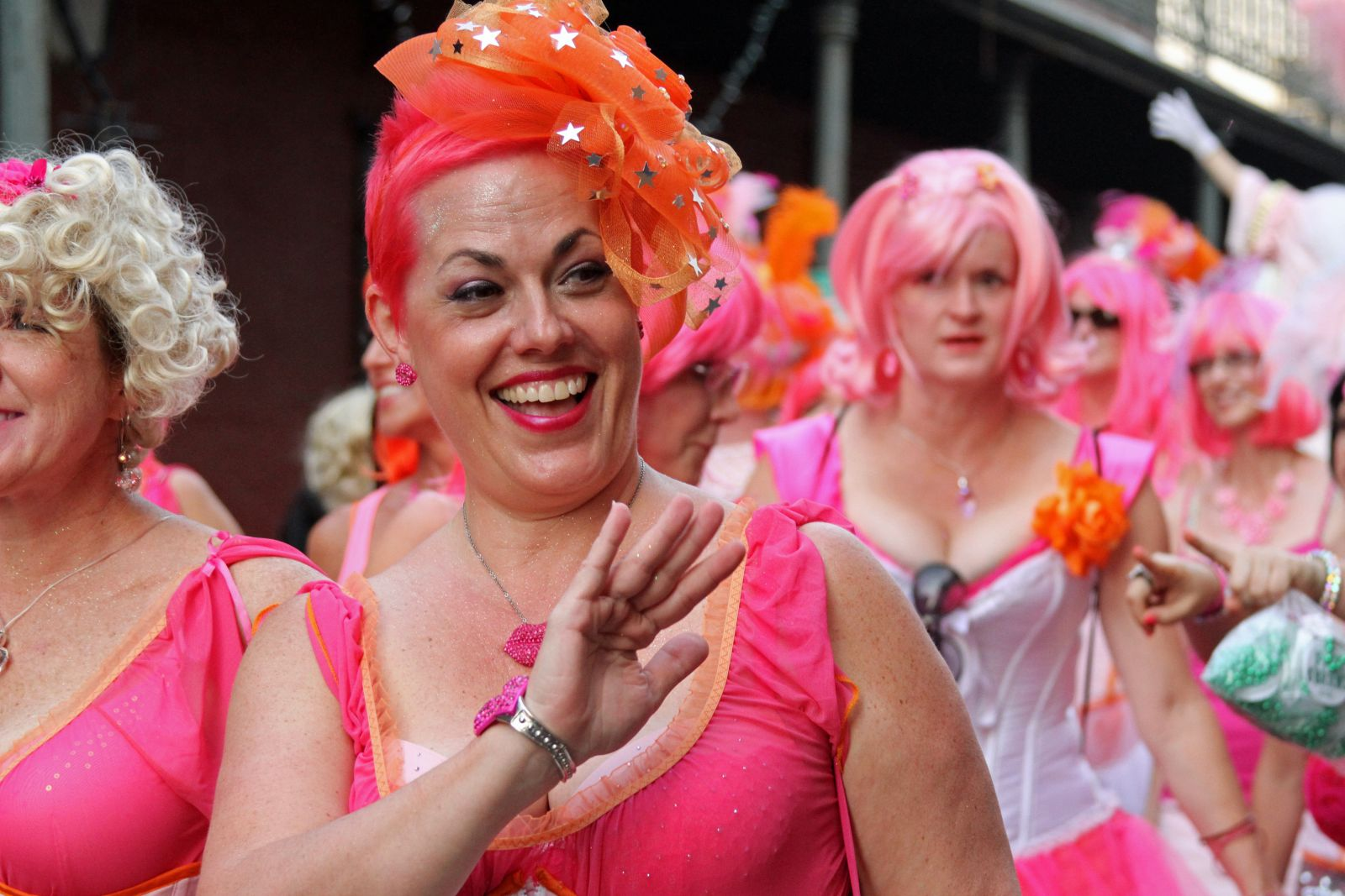 New Orlean's Festigals Saturday's stiletto stroll is a highlight as women dressed head to toe in pink danced to music in high heels and hot pink wigs through the French Quarter … and of course there was a lot of bead throwing. (Photo: Courtesy of www.experienceneworleans.com)