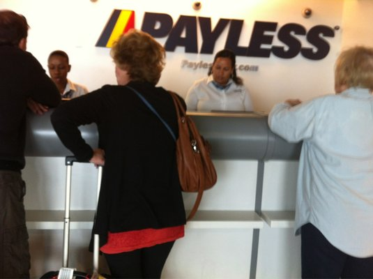 Travelers wait in line at Payless Car Rental to get their cheap rental car. (Photo: Courtesy of Yelp)