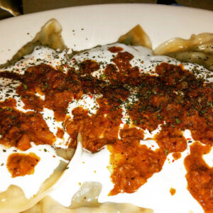 Aushakk, dumplings stuffed with leaks and spices adorned with ground beef and a yogurt sauce and topped off ground cumin, garlic, mint and paprika, at Khyber Pass Kabob Restaurant . (Photo: Super G)