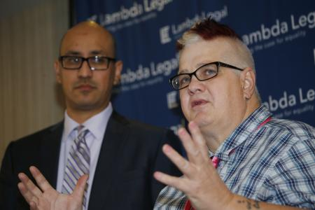 Dana Zzyym, right, the plaintiff in a federal discrimination lawsuit filed by Lambda Legal against the US State Department seeking more gender options for passports, responds to a question while Paul D. Castillo, staff attorney in the South Central Regional Office of Lambda Legal in Dallas, looks on during a news conference about the case Monday, October 26, 2015, in Denver, Colorado. Dana, an intersex person, was denied a US passport for refusing to check either male or female on the application form. (AP Photo/David Zalubowski)