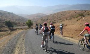 Cyclist touring through Morocco. Join WomenTours new Morocco: An Adventure Mosaic.