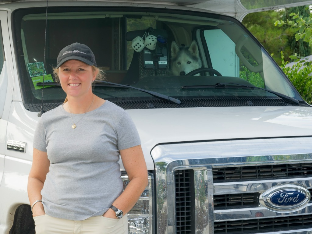 Dawn posing in front of her RV with her dog Nanook in the driver's seat at the Escondido RV Park in Escondido, California. (Photo: Courtesy of Dawn Wilson Photography)