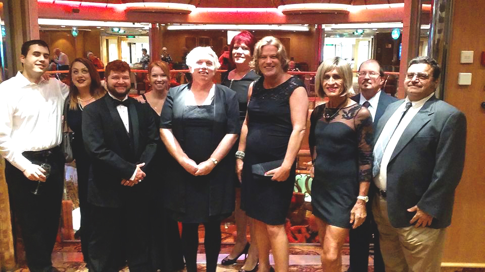 Stephanie Land, third from the right in the foreground, founder of Transgender Vacations, with Sherry Donegan, second from the right in the foreground, with some of the gender variant and ally travelers aboard the second annual Caribbean cruise. (Photo: Courtesy of Transgender Vacations)