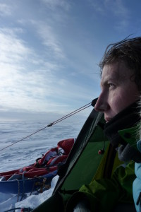 Felicity Aston, the first woman to ski across Antarctica solo, looking at the view from her tent. (Photo: Courtesy of Felicity Aston)