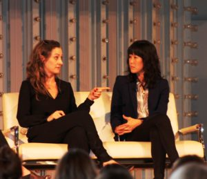 Audience members were on the edge of their seats as Paula Froelich, of Yahoo! Travel, left, and noted journalist Laura Ling, right, talked about how they got out of hot situations while chasing stories around the world at the Women's Travel Fest in San Francisco in 2014. (Photo: Heather Cassell)