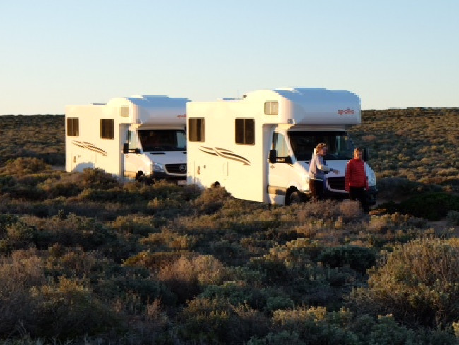 Girls on tour across Nullarbor Plains in two Apollo campervans. (Photo: Julia Champtaloup / The Daily Telegraph)