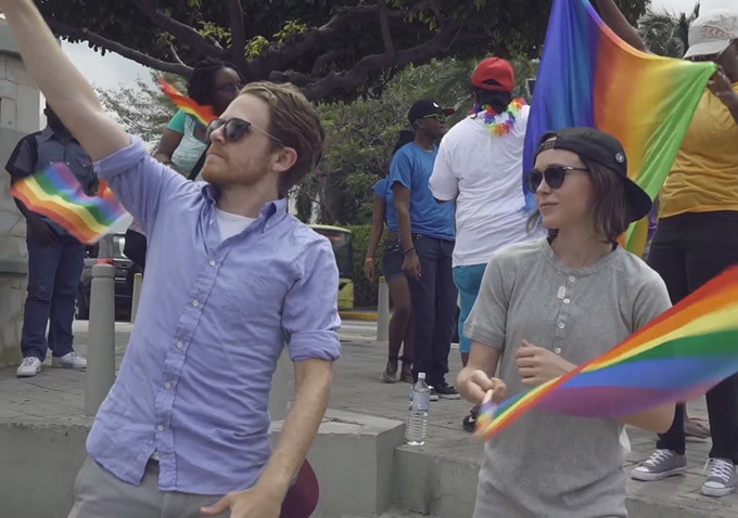 "Ian Daniel, left, and Ellen Page, right, participates in an LGBTQ Pride event during one of their journey's in ""Gaycation,"" their new LGBTQ travel show on Viceland. (Photo: Viceland)"