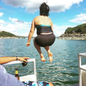 Girl Roamer Poonam Kapoor jumps into the water from our boat on Lake Travis in Texas. (Photo: Super G)