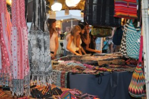Girls shopping for jewelry and art at Villagefest, every Thursday night in downtown Palm Springs, California. (Photo: Super G)
