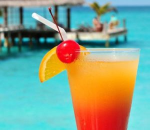 A cocktail on the beach. (Photo: Courtesy of savoredjourneys.com)