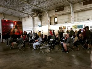 """Visitors admire and think about the images of women sliding before them on the screens that form a circle at the """"Women: New Portraits"""" exhibit at Crissy Field in the Presidio in San Francisco. (Photo: Heather Cassell)"""