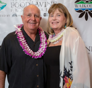Debi Bishop, right, and husband Tom Hollenbeck, left, at the Hawaii Food and Wine Festival. (Photo Courtesy of Waikoloa Resort)