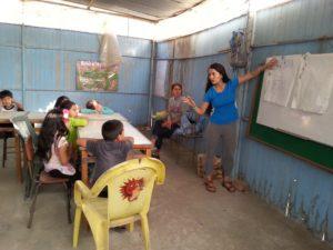 Diana Ventura, a recipient of the HI USA Explore the World Travel Scholarship, teaching at Light and Leadership Initiative in Peru. (Photo: Courtesy of HI USA)