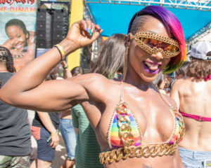 A Dinah reveler grooves to the music in disco rainbow style at the Cabana Pool Party. (Photo: Girls That Roam / Pipi Diamond)
