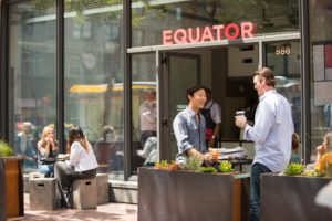 Coffee connoisseurs enjoy espressos and specialty coffees at Equator Coffees & Teas' San Francisco café on Market Street. (Photo: Courtesy of Equator Coffees & Teas)