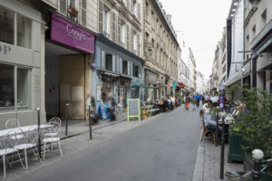 The bustling street filled with restaurants, cafes, shops, and bars on rue Cadet just outside Cosy's Apartments Cadet. (Photo: Hotels)