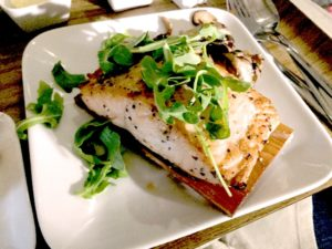 The Cedar Planked Salmon seasoned with a honey balsamic glaze and shiitake mushrooms served with roasted shiitake and arugula salad. (Photo: Ms. H.)