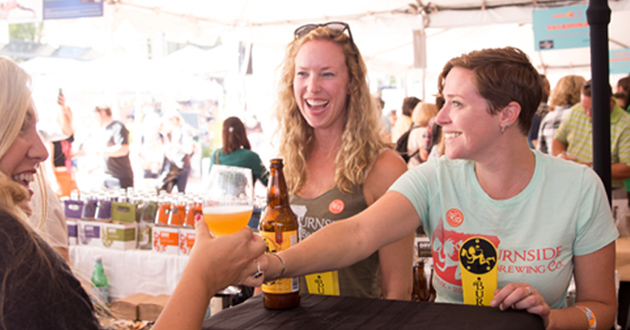 Women enjoy sampling the bites at the Friday Grand Tasting at Feast Portland 2015. (Photo: Courtesy of Feast Portland)