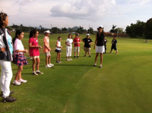 Kellie leading a group of young girl golfers during a day at the junior golf program at Puakea Golf Course. (Photo: Puakea Golf Course)
