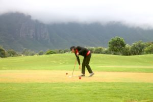 Kellie, amateur pro and former general manager of Puakea Golf Course, out on the course with Super G. (Photo: Super G)