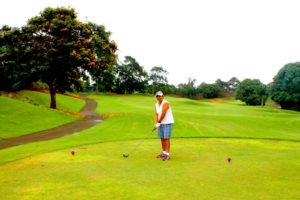 Super G teeing off with the driver at Puakea Golf Course during her game with Kellie. (Photo: Super G)