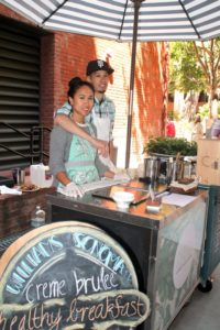Rica Sunga-Kwan, left, owner and ice cream maker of Churn Urban Creamery, with her husband Christopher Kwan, right, helping her out at the cart. (Photo: Heather Cassell)