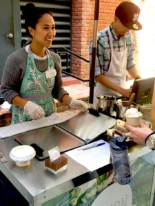 Rica Sunga-Kwan, owner and ice cream maker of Churn Urban Creamery, helps a customer satisfy her sweet tooth. (Photo: Heather Cassell)
