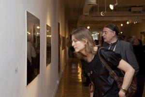 Corinne Erni examining an exhibit.