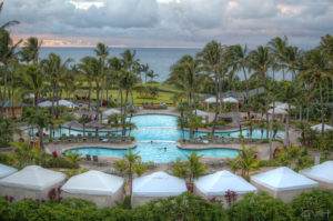 Relax by one of the pools at the Ritz-Carlton Kapalua's three tiered pool with views of the Pacific Ocean. (Photo: Courtesy of the Ritz-Carlton Kapalua)