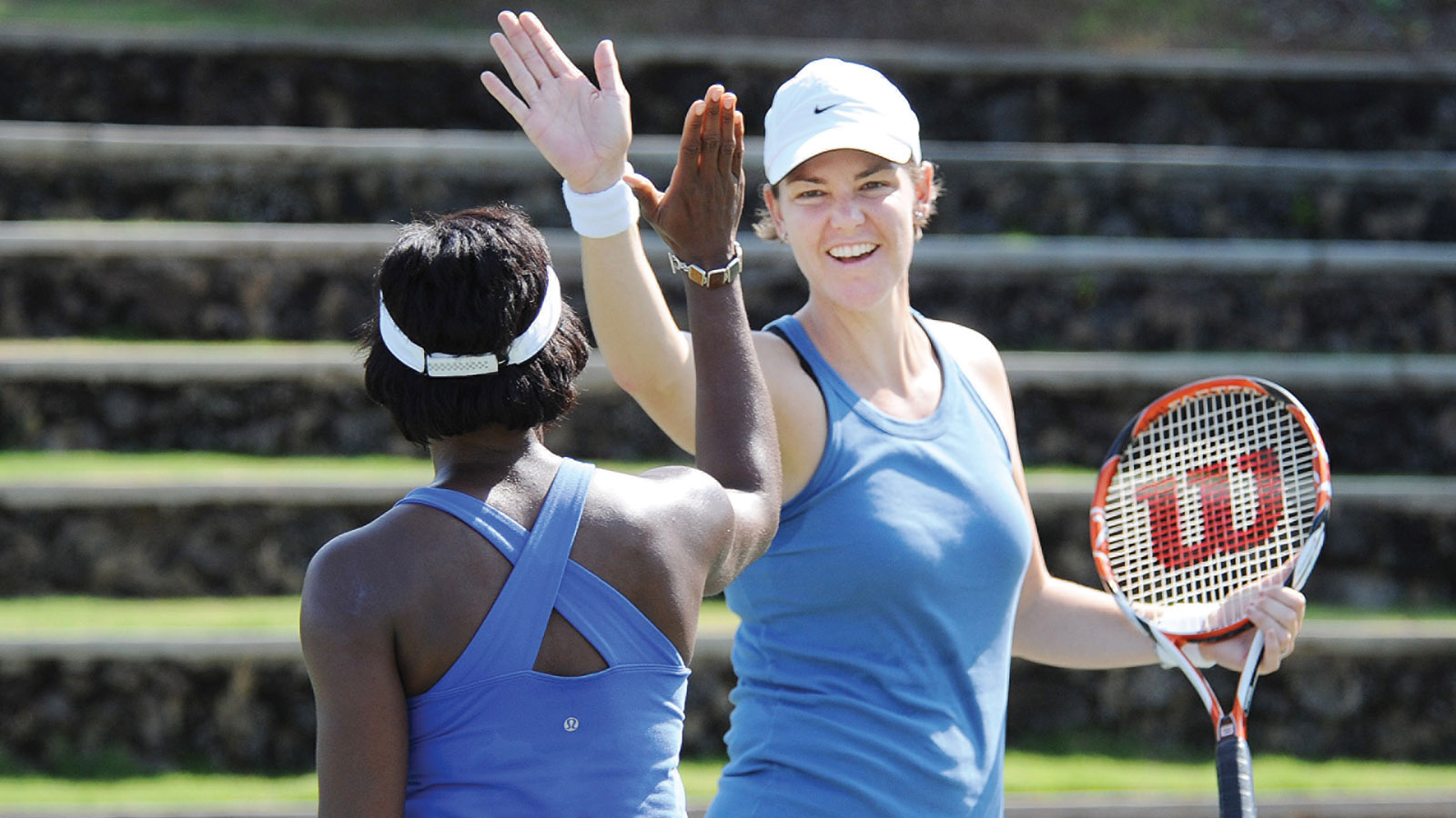 Lindsay Davenport gives New Jersey's Lisa Webber a high five after Webber's put-away at the net at the Wailea Fantasy Camp clinic Friday morning. (Photo: Courtesy of the Four Seasons Maui)