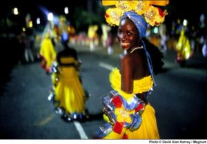 CUBA. Santiago de Cuba. 1998. Costumed dancers on the street during carnival. (Photo: David Alan Harvey / Magnum / Global Exchange Reality Tours*)