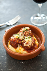 An exquisite meal, like the Prato Meatballs accompanied by roasted tomatoes and cippolini conserva, can be found at Prato in Orlando, Florida. (Photo: Courtesy of Prato)