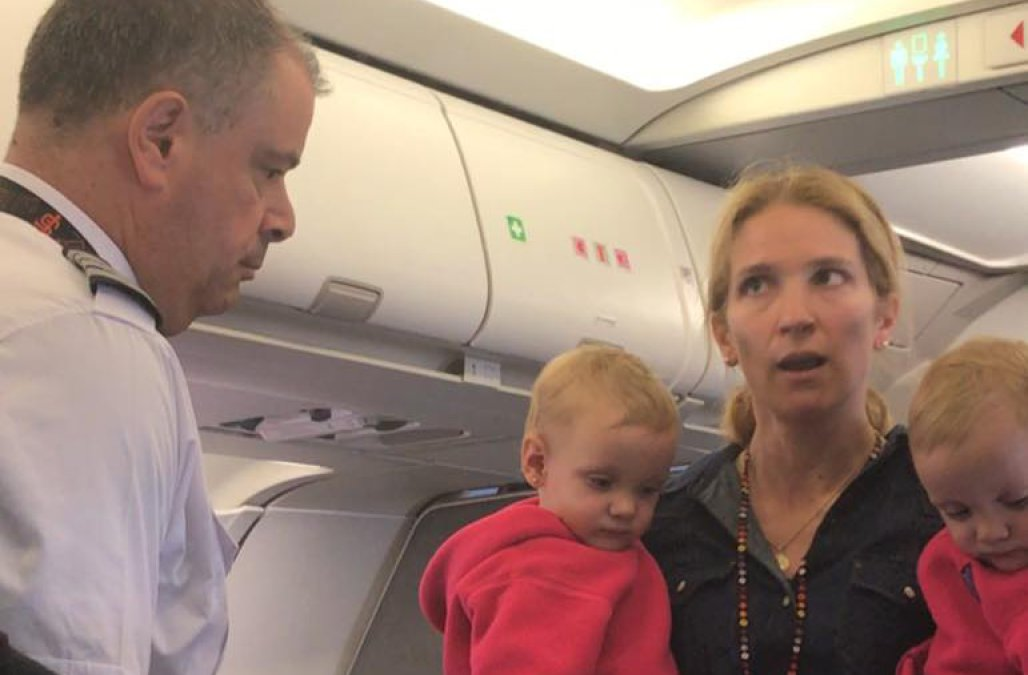 Unidentified woman and her two children speaking with the American Airlines' captain during Friday's incident where a flight attendant allegedly nearly struck her child and her with their stroller while boarding a flight from San Francisco International to Dallas-Fort Worth International Airport. (Photo: Facebook)