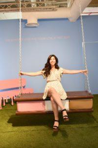 Girl swinging on the ice cream sandwich swing at the Museum of Ice Cream. (Photo: Museum of Ice Cream)