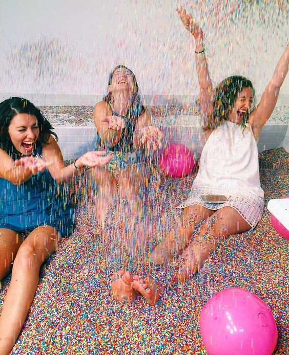 Girls get giddy in the Sprinkles Pool at the Museum of Ice Cream. (Photo: Pintrest)