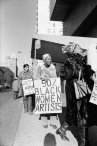 Jan van Raay (American born 1942). Faith Ringgold (right) and Michele Wallace (middle) at Art Workers Coalition Protest, Whitney Museum, 1971. (Photo: Jan van Raay)