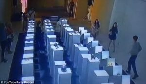 Simon Birch exhibit of crowns on a pedestal topple like dominos following a selfie gone bad at the 14th Factory Pop-Up Gallery in Los Angeles. (Photo: Courtesy of YouTube/Party Pooper)