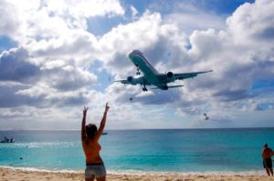 A girl watching a plane coming in for a landing at Maho Beach in Saint Martin. (Photo: Courtesy of TripAdvisor)