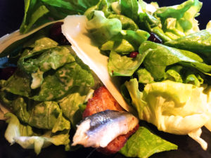 """The Lexington House's the Butter Lettuce """"Caesar"""" with Nicoise Olives, Crostini, and Parmesan Cheese (Photo: Super G)"""