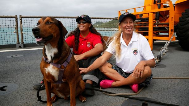 Tasha, Jennifer and their two dogs were rescued by the USS Ashland months after their boat became adrift in the Pacific. (Photo: Associated Press)