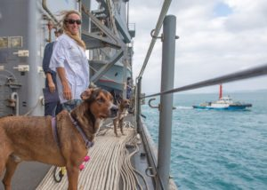 Jennifer Appel, a rescued sailor, pose with dogs Zeus and Valentine on board the USS Ashland. (Photo: US Navy)