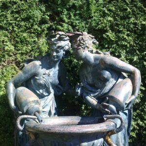 Two women caught in an intimate moment over a small pond around a calm green corner at Crystal Palace Gardens in Porto, Portugal. (Photo: Courtesy of Fresh Lobster Tours)