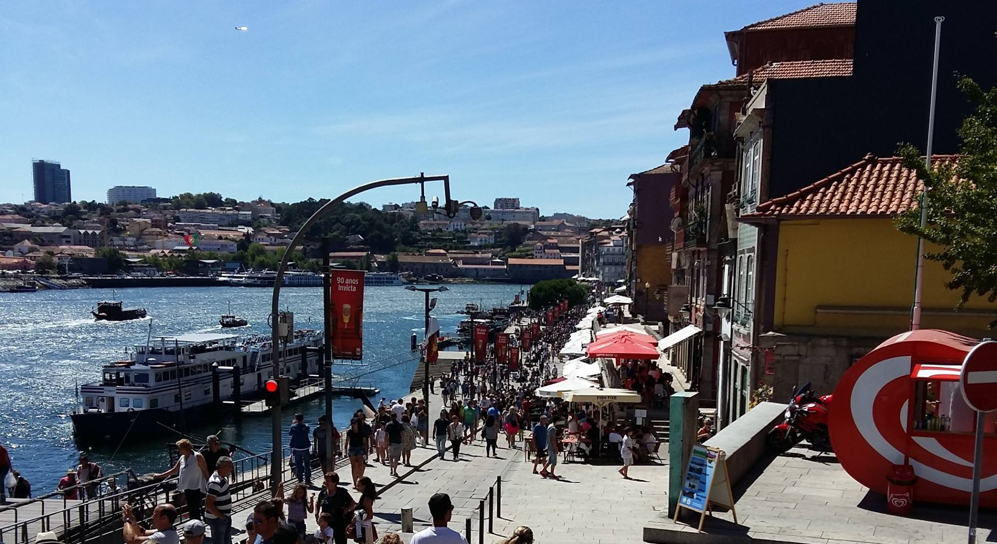 Shopping and eating along the Ribeira, the city's riverfront promenade in Porto, Portugal. (Photo: Courtesy of Fresh Lobster Tours)