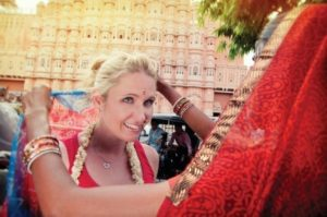 white women being dressed in a sari in Nepal